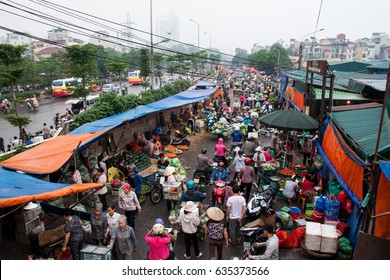 Hanoi,VietNam May 07,2017: Aerial view of vegetable stalls by Long Bien fruit market, with early morning sunlight.