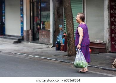 Hanoi,VietNam May 07,2017: old women buys vegetables