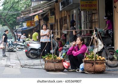 Hanoi,VietNam May 07,2017: Vietnamese woman selling vegetables, fruit in old town in Hanoi, Vietnam