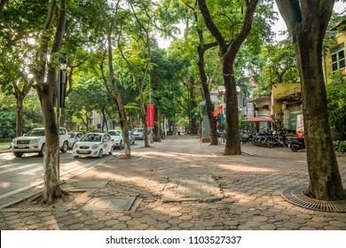 Hanoi,Vietnam - November 1,2017 : Street view and view of traffic with motorbikes and vehicles in Hanoi Old Quarter, Vietnam.