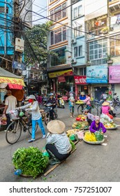 Hanoi,Vietnam - November 2,2017 : Busy local daily life of the morning street market in Hanoi, Vietnam. A busy crowd of sellers and buyers in the market.