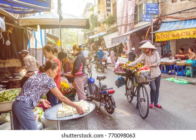 Hanoi,Vietnam - November 2,2017 : Busy local daily life of the morning street market in Hanoi, Vietnam. People can seen exploring around the market.