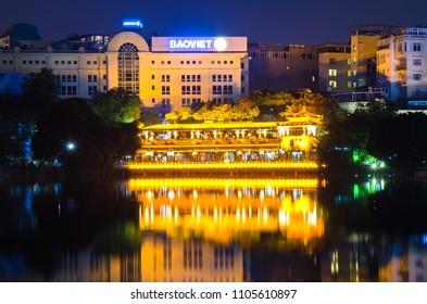 "Hanoi,Vietnam - November 2,2017 : Night view of the lake side in Hoan Kiem Lake. Hoan Kiem Lake meaning ""Lake of the Returned Sword""."