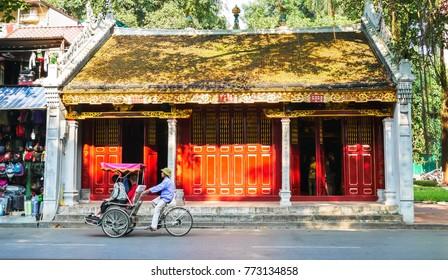 Hanoi,Vietnam - November 2,2017 : Tourist taking a tour to exploring around Hanoi with Vietnamese trishaw.