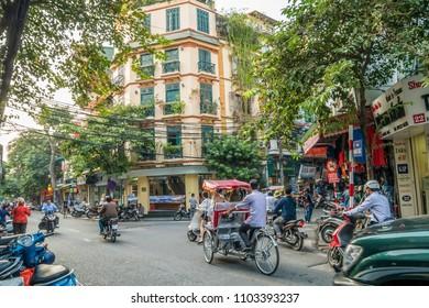 Hanoi,Vietnam - November 2,2017 : Tourists taking a tour to exploring around Hanoi with Vietnamese rickshaw.