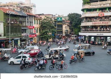 Hanoi,Vietnam - November 2,2017 : View of busy traffic in an intersection with many motorbikes and vehicles in Hanoi, capital of Vietnam.