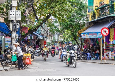 Hanoi,Vietnam - November 5,2017 : Local daily life and view of busy traffic with motorbikes in Hanoi Old Quarter, capital of Vietnam.People can seen exploring it.