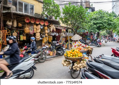 Hanoi,Vietnam - November 5,2017 : Local daily life of the street in Hanoi, Vietnam. Street vendors selling various types of vegetables from their bicycle in Hanoi Old Quarter.