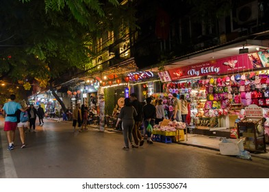 Hanoi,Vietnam - November 5,2017 : Night life of the street view in Hanoi Old Quarter, people can seen exploring and shopping around it.