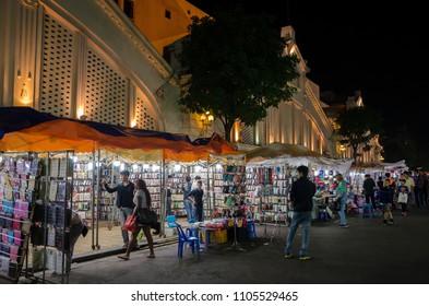 Hanoi,Vietnam - November 5,2017 : Night street market in Hanoi Old Quarter, people can seen exploring around it.