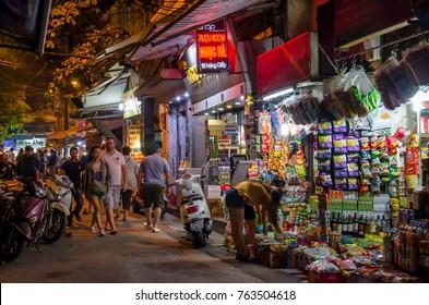 Hanoi,Vietnam - November 5,2017 : Night street view in Hanoi Old Quarter, people can seen exploring around it.