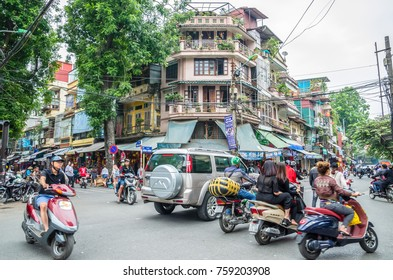 Hanoi,Vietnam - November 5,2017 : View of busy traffic in an intersection with many motorbikes and vehicles in Hanoi Old Quarter, capital of Vietnam.