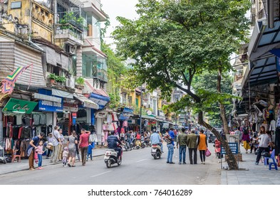Hanoi,Vietnam - November 5,2017 : View of busy traffic with many motorbikes and vehicles in Hanoi Old Quarter, capital of Vietnam.