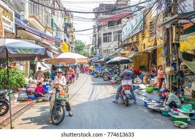 Hanoi,Vietnam - October 31,2017 : Busy local daily life of the morning street market in Hanoi, Vietnam. A busy crowd of sellers and buyers in the market.
