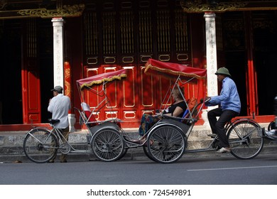 hanoi,vietnam, sep 21, 2017: Life in vietnam- Cyclo beside Sword lake in hanoi, vietnam. Cyclo is the tourist's favourite vehicle transportation in vietnam