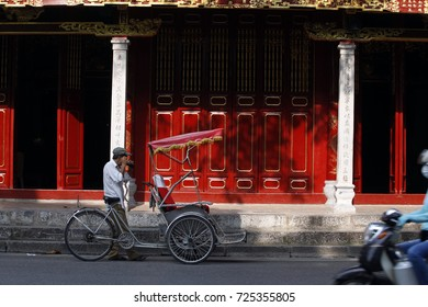 hanoi,vietnam, sep 21, 2017: hanoi,vietnam: tourists visit the Hanoi' Old Quater by cyclo on Sep 21, 2017. Cyclo is transportation favorite for visiting hanoi