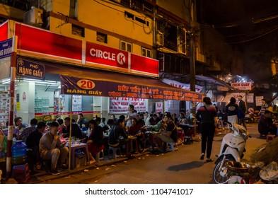 Hanoi,Vietname - November 5,2017 - People can seen enjoying their food at the food stalls in Hanoi,Vietnam.