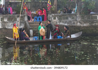 HANOI,VIETNAM-FEB 14,2016: An unidentified group of artisans are performing folk music (Quan Ho) on the boat. This traditional art is recognised as the Intangible Cultural Heritage by UNESCO in 2009.
