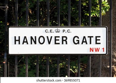 Hanover Gate road plate on a fence in London.