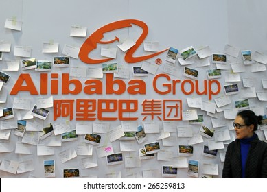 HANOVER, GERMANY, CIRCA MARCH 2015 - Woman posing in front of a booth of the Alibaba Group, from China.