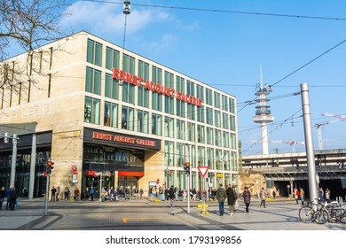 Hanover, Germany – January 27, 2018. Ernst August Galerie shopping mall on Ernst-August-Platz street in Hanover. View with people and bicycles, in winter.