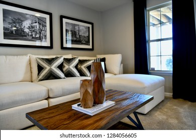 HANOVER, MD, USA - MARCH 21, 2018: Living room with sofa couch inside modern home.