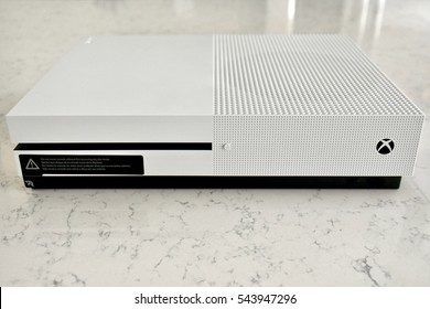 HANOVER, USA - DECEMBER 27, 2016: A White Xbox One S console and controller on a carrera marble surface.