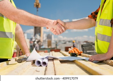 Hanshake seals an agreement at construction site