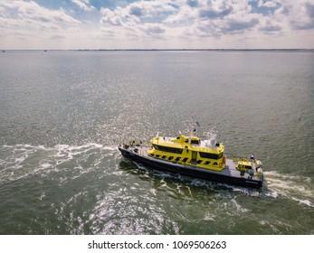 Hansweert Netherlands April 2018 , Port of the lock conection from the schelde river to Oosterschelde, inland shipping and Rijkswaterstaat ship