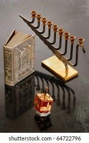 A hanukiah, dreidel and prayer book for Hanukkah