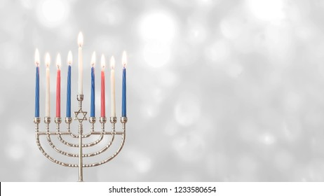 Hanukkah (Chanukah) Jewish holiday background with menorah (Judaism candelabra) for Festival of Lights and Feast of Dedication with burning candles and traditional on white silver winter snow bokeh
