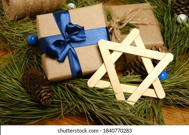Hanukkah. A gift, a symbol of Hanukkah. star of David. Around the fir branches and cones