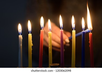Hanukkah Jewish holiday celebrated eight days to mark the 8 days oil burned. People celebrate Chanukah by lighting candles on a menorah, also called a Hanukiyah. Each night, one more candle is lit.