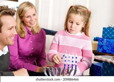 Hanukkah: Little Girl Lights Menorah Candles To Celebrate