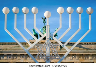 Hanukkah Menorah at Brandenburg gate on Parizer Platz Street in German City centre. Brandenburger tor