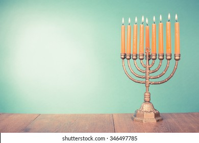 Hanukkah menorah with burning candles. Retro old style filtered photo