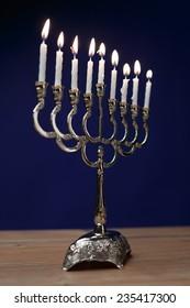 Hanukkah menorah with candles. Shallow depth of field.