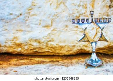 Hanukkah Menorah, also Chanukiah Menorah or Hanukkiah Menorah. Menorah - Jewish Holiday Symbol Hanukkah. Nine-branched Jewish candelabrum lit during the eight-day holiday of Hanukkah. Israel