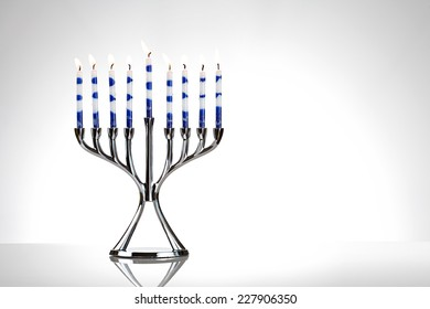 Hanukkah: Menorah Filled With Lit Candles For Holiday