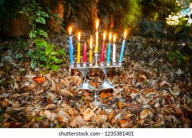 Hanukkah Menorah in the form of a Jewish star Magen David and Wood Dreidel, Israel. Menorah - Jewish candelabrum for Jewish Holiday Hanukkah. Dreidel - Toy with Hanukkah