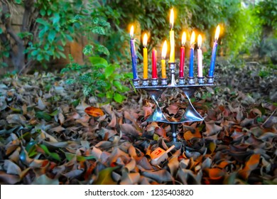 Hanukkah Menorah in the form of a Jewish star Magen David and Sevivon (Dreidel), Israel. Image for Happy Hanukkah. Menorah - candelabrum for Jewish Holiday Hanukkah. Sevivon - Toy of Hanukkah