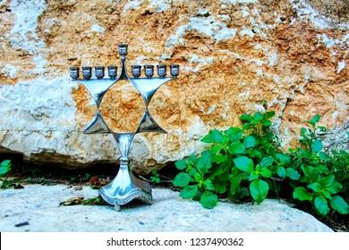 Hanukkah Menorah, also Hanukkiah or Chanukiah Menorah. Menorah in the form of a Jewish star Magen David in Israel. Menorah (Jewish candelabrum) - Jewish Holiday Symbol Hanukkah