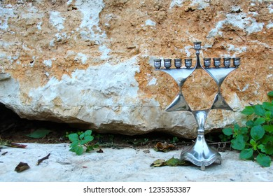 Hanukkah Menorah, also Hanukkiah Menorah or Chanukiah Menorah. Menorah - Jewish Holiday Symbol Hanukkah. Nine-branched Jewish candelabrum lit during the eight-day holiday of Hanukkah. Israel