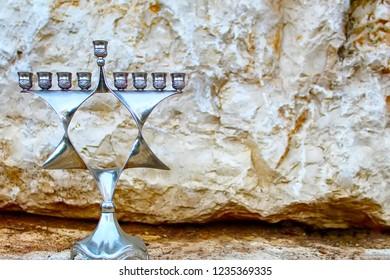 Hanukkah Menorah, also Hanukkiah Menorah or Chanukiah Menorah. Jewish candelabrum - Jewish Holiday Symbol Hanukkah. Menorah in the form of a Jewish star Magen David, Israel