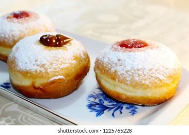 Hanukkah Sufganiyot (Sufganiyah). Hanukkah (Chanukah, Hanuka) - Jewish Holiday. Sufganiyah (Sufganiyot) - Festive Doughnut or Donut. Image of Jewish Holiday Hanukkah. Symbol Hanukkah, Food