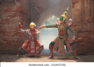Hanuman (monkey god) fighting Thotsakan (giant) in Khon masked dance drama (Traditional Thai Pantomime) as cultural dancing arts performance in mask dressed based on character in Ramakien or Ramayana.