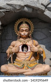 Hanuman statue, Hindu idol near Ganges River, Rishikesh, India. Sacred places for pilgrims. Statue that portray Lord Hanuman tear open his chest and reveal Lord Rama and Sita inside it, in heart