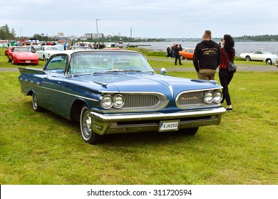 HAPARANDA, SWEDEN - JULY 11, 2015:Wheels Nationals car meet draw 30000 visitors and become bigger each year. After meeting cars long go around city that all passersby could see and photograph them