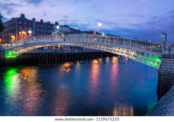 Ha'penny bridge Halfpenny Bridge over River Liffey in the evening, Dublin Ireland Europe EU