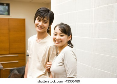 A happily young couple in the kitchen